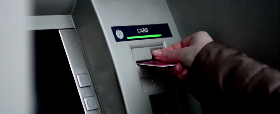 A man withdrawing money from ATM machine